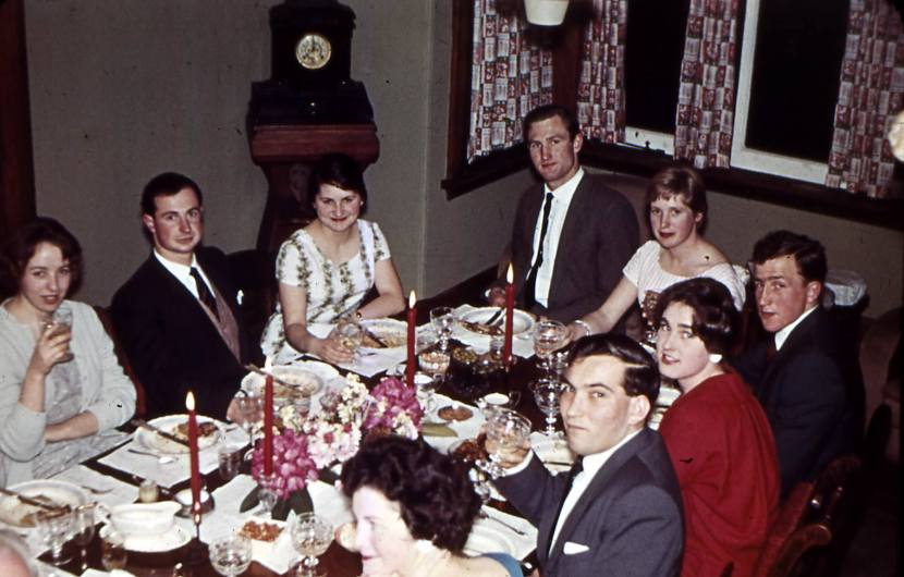 Dinner party at Toad Hall. [eLeft -right] Guest, Fred Strange, guest, John Allan, guest, Lachie Watson, guest, George Salmond. Jim Scott Collection.